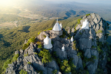 Spectacular Aerial View Of Floating Pagodas On The Mountain Cliff At Wat Chaloem Phra Kiat In Chae Hom District, Lampang Province, Thailand.