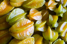 Pile Of Fresh Ripe Yellow Carambola Star Fruits On Display At A Tropical Farmers Market