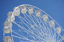 Small Observation Wheel Against Blue Sky