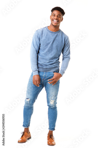 Fotomural  Full body smiling young black man standing against isolated white background