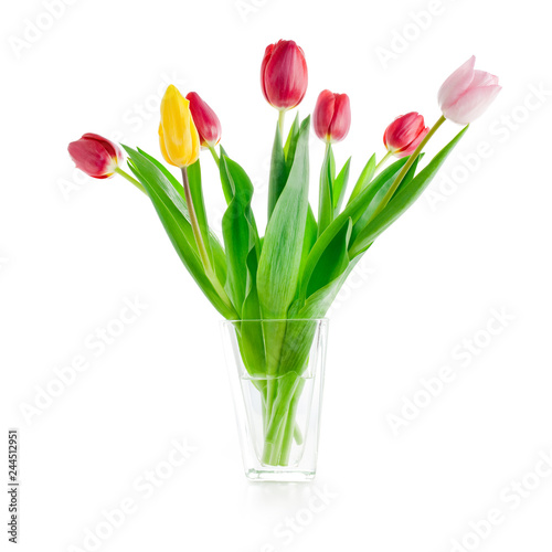 bouquet of fresh tulip flowers in glass vase, isolated on white background with clipping path included
