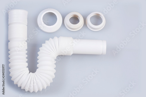 Photo Plastic pipe with water trap, isolated - Plastic flexible siphon