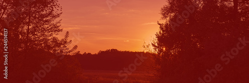 Sunset in the meadow, countryside landscape. Web banner for design.