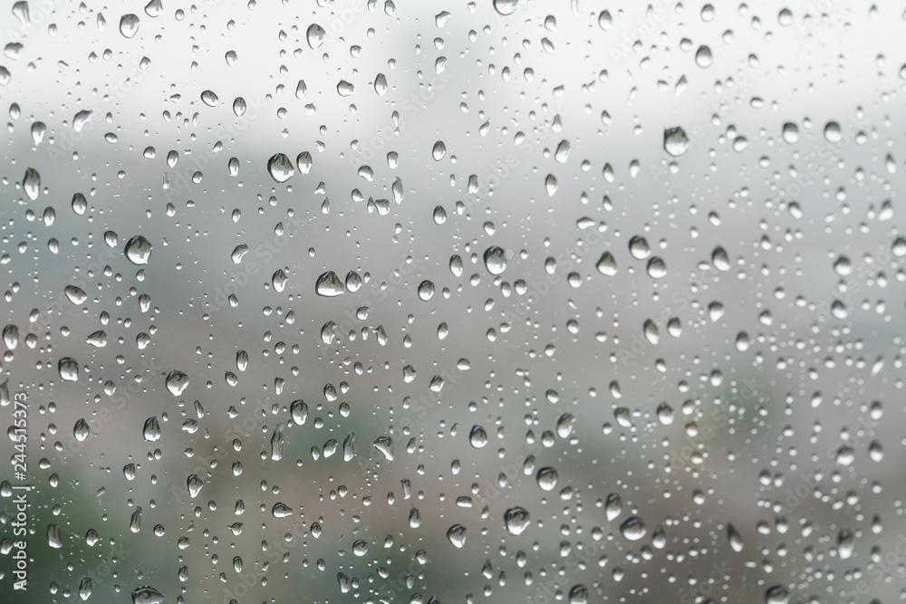 Fototapety, obrazy: Rain drops on a window pane in a rainy day