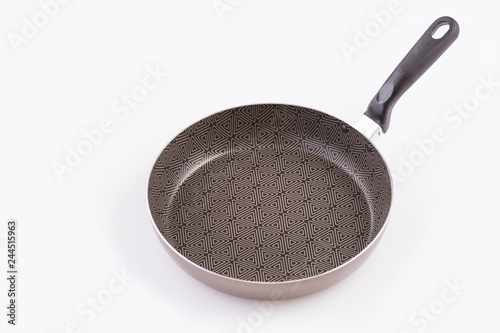 Fotografía  Black frying pan isolated on white - Top view
