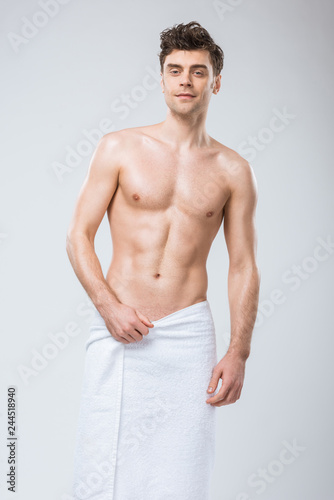 handsome sexy muscular man posing in towel isolated on grey - Buy ... 0b432d9ff