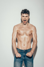 Sexy Shirtless Emotional Man In Jeans Screaming And Posing On Grey