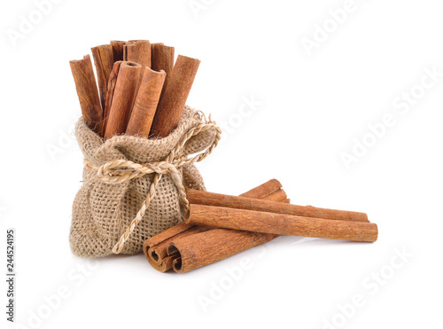 dried cinnamon stick in sack and on white background