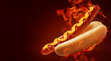 Hot Dog With Big Sausage And Mustard On Fire Background