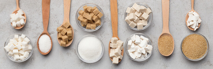 Collection of different kinds of sugar on gray background
