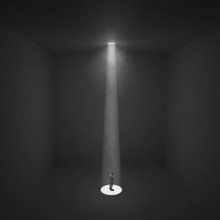 Man Stands Under The Ray Of Light In A Dark Room