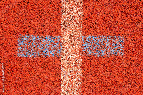 Poster de jardin Rouge Red running track Synthetic rubber on the athletic stadium.