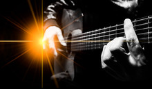 Closeup Male Artist Hands Playing Acoustic Guitar On Stage With Concert Light