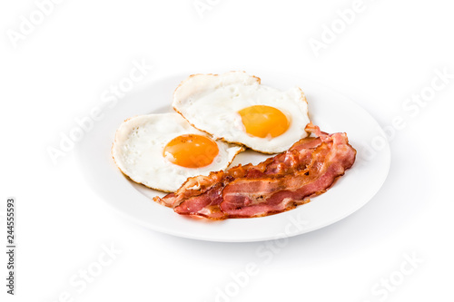Fried eggs and bacon for breakfast isolated on white background