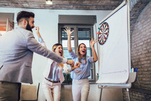 Business People Making Team Training Exercise During Team Building Seminar, Play Darts