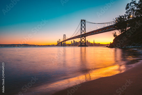 San Francisco skyline with Oakland Bay Bridge at twilight, California, USA