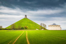 Famous Lion's Mound Memorial Site At The Battlefield Of Waterloo With Dark Clouds, Belgium