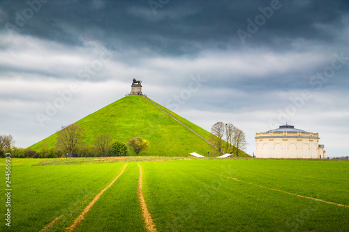 Fototapeta Famous Lion's Mound memorial site at the battlefield of Waterloo with dark cloud