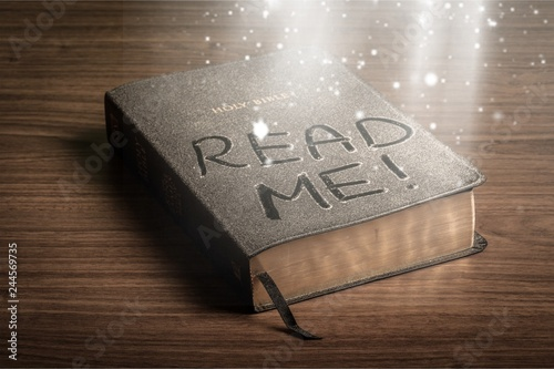 Fotografia  Holy Bible  book with read me letters on a wooden background