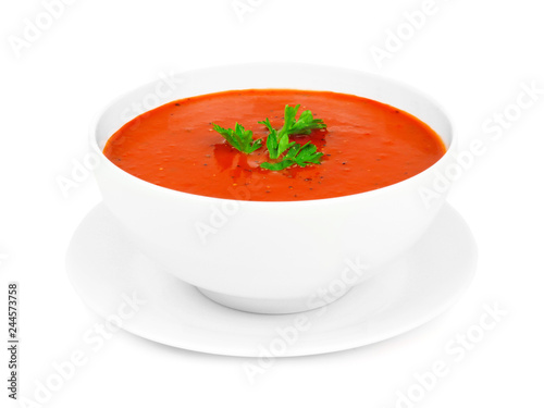 Leinwand Poster Homemade tomato soup in a white bowl with saucer