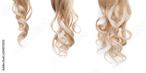 Fotografie, Obraz  Blond long wavy hair on a white background