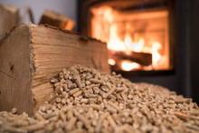 Wood Stove Heating With In Foreground Wood Pellets - Economical Heating System Concept