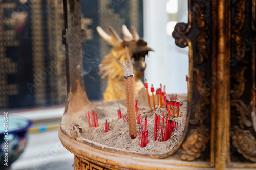 Fotografija  Burning incense on censer at chinese shrine.
