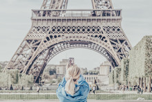 Girl Taking Pictures Of Eiffel Tower.