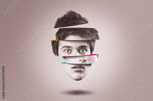 Obraz Split personality concept. Isolated cutout head of person with mental health disorder - fototapety do salonu