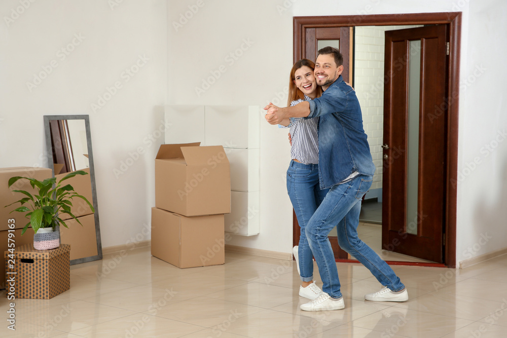 Fototapety, obrazy: Couple dancing near moving boxes in their new house