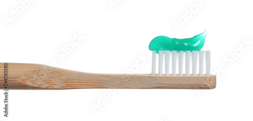 Obraz na plátně Wooden toothbrush with paste isolated on white
