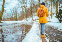 Woman Walking By City Park Pas...