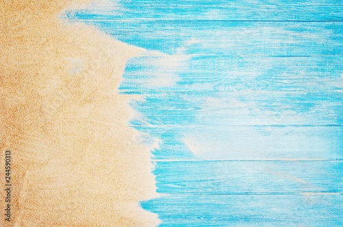 Obraz Top view of sandy beach and marine blue planks pier. Background with copy space and visible sand and wood texture. - fototapety do salonu