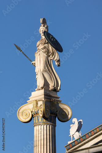 Foto  Sunset view of Athena statue in front of Academy of Athens, Attica, Greece