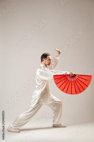 Senior master practicing qi qong taijiquan at studio