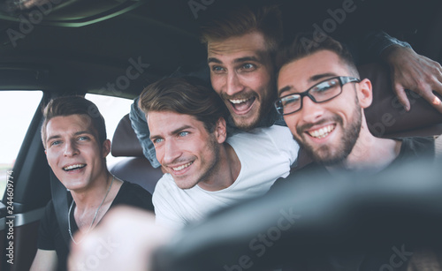 Friends renting a car and driving somewhere Wallpaper Mural