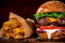Tasty Burger On Wooden Table.