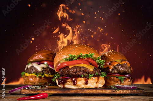 Tasty burger with french fries and fire.