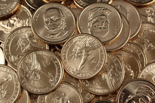 A Close Up Image Of A Pile Of American One Dollar Coins On A Clean, Black Background