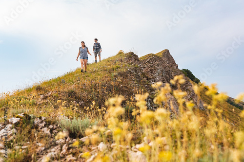 фотография Couple walking and hiking at mountains in spring