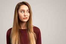 Dissatisfied Female Frowns Face, Has Disgusting Expression. Lovely Woman Feels Worried, Makes Mistake And Looks Awkward. People And Negative Facial Expressions