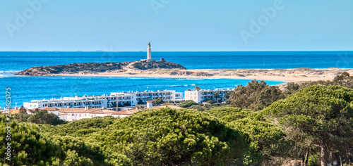 Panoramic view of the Caños de Meca, with the Trafalgar lighthouse in the background, in a photo taken from the pine forest of La Breña, Barbate, Spain