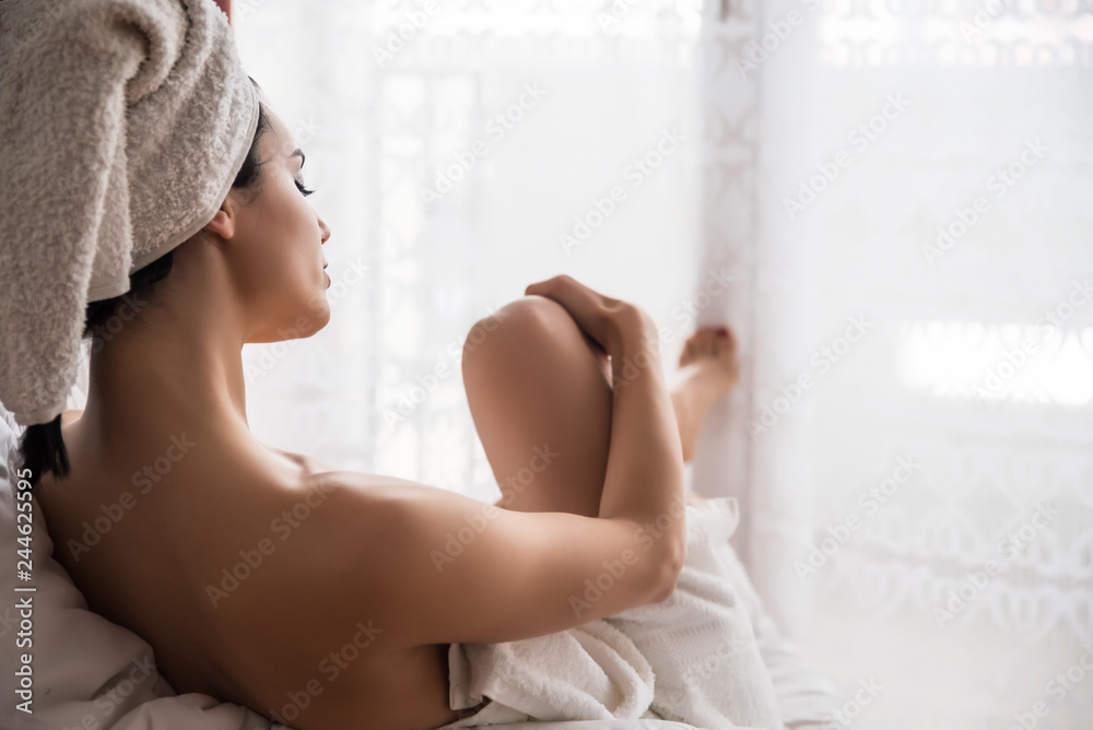 Fototapeta Girl wrapped in towels