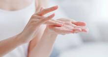 Woman Apply Moisturizer In Hand