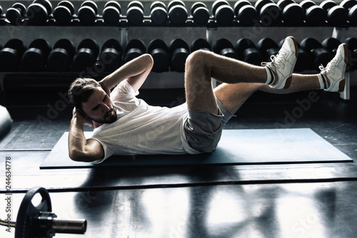 Fotografie, Obraz  Portrait of sporty man exercising in fitness gym