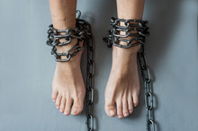 Female Legs In Chains. Slavery...