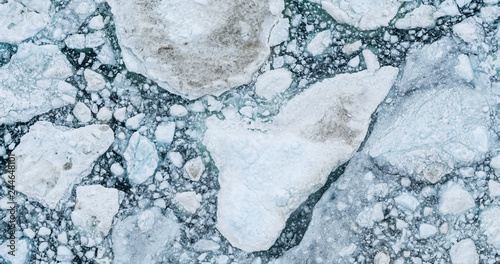 Fotografia, Obraz Icebergs drone aerial image top view - Climate Change and Global Warming