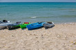 Colourful kayaks on sandy beach. The concept of active rest