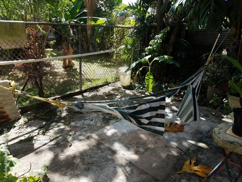 Fotografie, Obraz  broken or ripped green and white hammock over cement in Puerto Rico