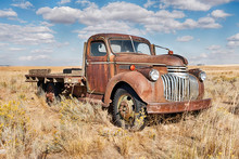 Rusting Farm Truck In Field
